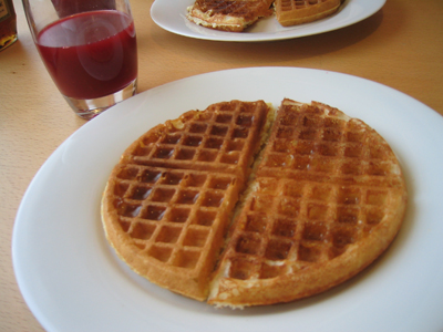 and Yeasted Waffles (on the right), topped with a little maple syrup.